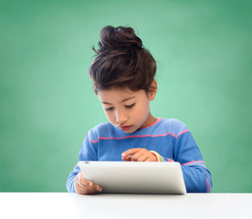 little girl with tablet pc at school