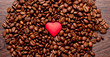 red heart on coffee beans