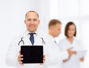 smiling male doctor with stethoscope and tablet pc