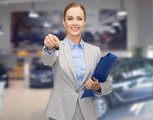 businesswoman or saleswoman giving car key