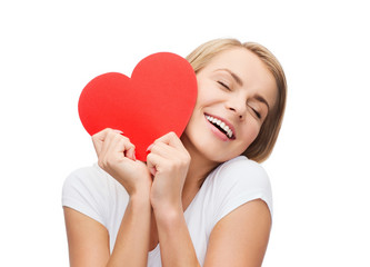 smiling woman in white t-shirt with heart