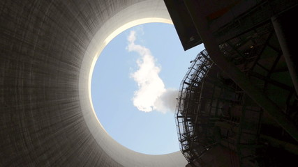 Steam rises from cooling tower