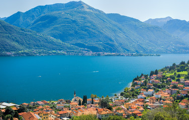 Colorful image of Lake Como and its blue water on a sunny day
