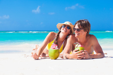 close up of young couple enjoying their time drinking a coconut