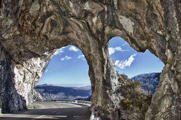natural rock arches in provence mountain road