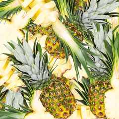 Abstract background with slices of fresh pineapple