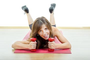 Caucasian happy female fitness model on mat