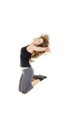 Full body of cheerful young pretty fit girl or woman jumping