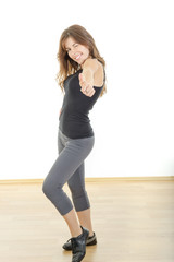 Smiling beautiful sporty fit athletic girl or woman with thumb u