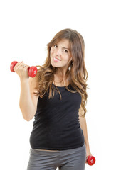 Smiling beautiful sporty fit athletic girl with weights or red d
