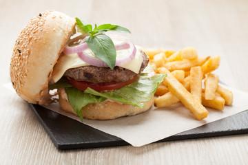 Wheat beef sandwich hamburger, fried potatoes, ketchup served fo
