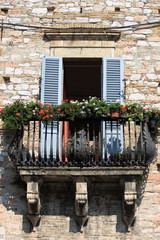 Medieval balcony with flower pots