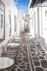 Narrow street with white houses on Paros island, Greece