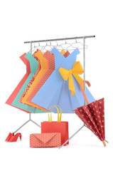 Fashion clothes: hangers with ladies paper dresses