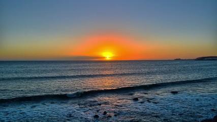 Sunset over the sea in Maspalomas, Gran Canaria, Canary Islands.