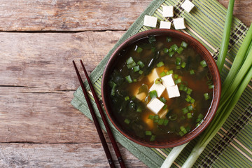 Japanese miso soup in a brown bowl horizontal top view