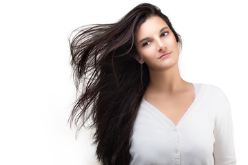 Beautiful Young Woman with Air Blown Hair. Healthy Long Hair