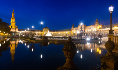 night view of Plaza de Espana with reflections