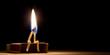 Leinwandbild Motiv two matches burning sitting together on the matchbox in the dark