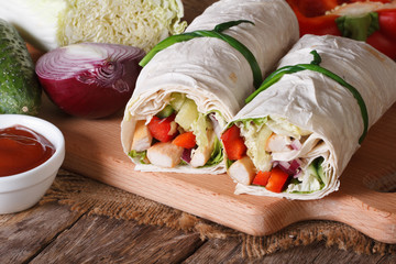 Burrito with chicken, vegetables with ingredients, horizontal