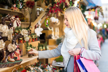 Beautiful blond woman buying decorations