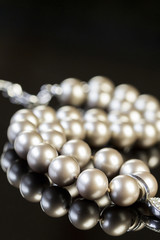 Elegant Pearl Necklace on Glossy Table