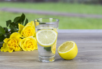 Glass of fresh cold mineral water with  of fresh lemon