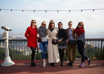 Group of six attractive women making vacation photo outdoors