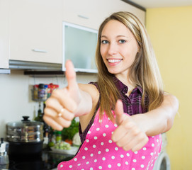 Girl showing thumbs up