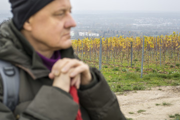 Relaxation. Blind person having a walk in the vineyard in autumn