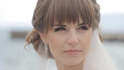 Beautiful girl looking in white wedding dress