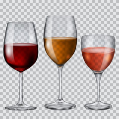 Transparent glass goblets with wine