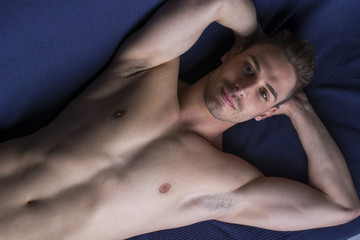 Handsome latin young man naked on floor or couch
