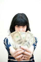 Brunette girl showing out of focus money in hands
