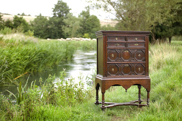 Chest of drawers on stand outdoors by a river