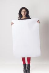 Woman holding white blank billboard