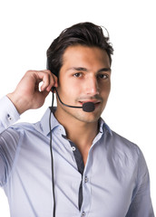 Young male telemarketer or support center receptionist