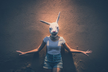 young hipster woman with rabbit mask