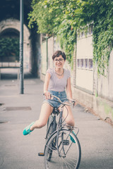 young hipster woman with bike