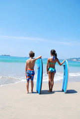 Boy and girl with boards