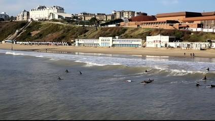 Surfers on Bournemouth beach Dorset England UK near Poole
