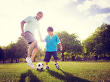 Fototapety Family Father Son Playing Football Summer Concept