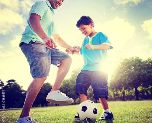 canvas print picture Family Father Son Playing Football Summer Concept