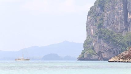 RAILAY,KRABI/THAILAND - OCTOBER 16 2014: yacht sail  near green