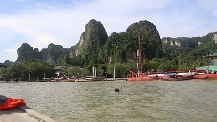 RAILAY,KRABI/THAILAND - OCTOBER 16 2014: Boat float to the pier