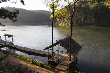Hut and wooden bridge on Pang Oung lake, Thailand