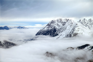 The low clouds over high mountains in winter day