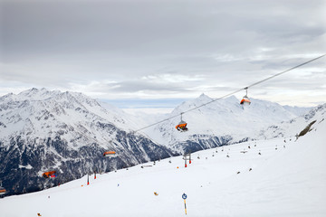 The chair lift on european mountain resort in cloudy weather