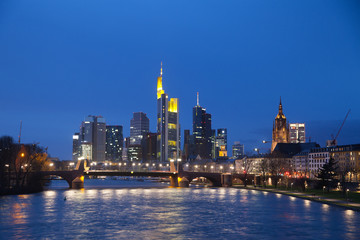 The view of Frankfurt's skyscrapers at dusk time from bridge