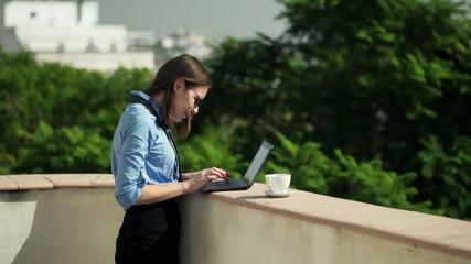businesswoman working on laptop on terrace